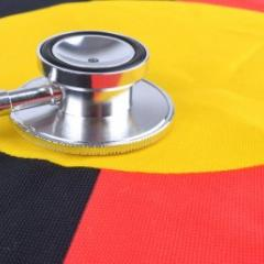 Image of stethoscope on Indigenous flag